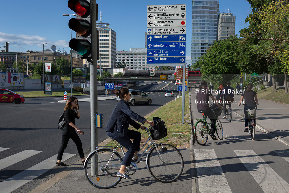 Cyclists ride on Dunajska Cesta in the Slovenian capital, Ljubljana, on 27th June 2018, in Ljubljana, Slovenia. Ljubljana is a small city with flat terrain and a good cycling infrastructure. It was featured at eighth on the 'Copenhagenize' index listing the most bike-friendly cities in the world. A new bike counter on Dunajska Street declares publicly that there are many days with more than 5,000 cyclists who take a trip through there.