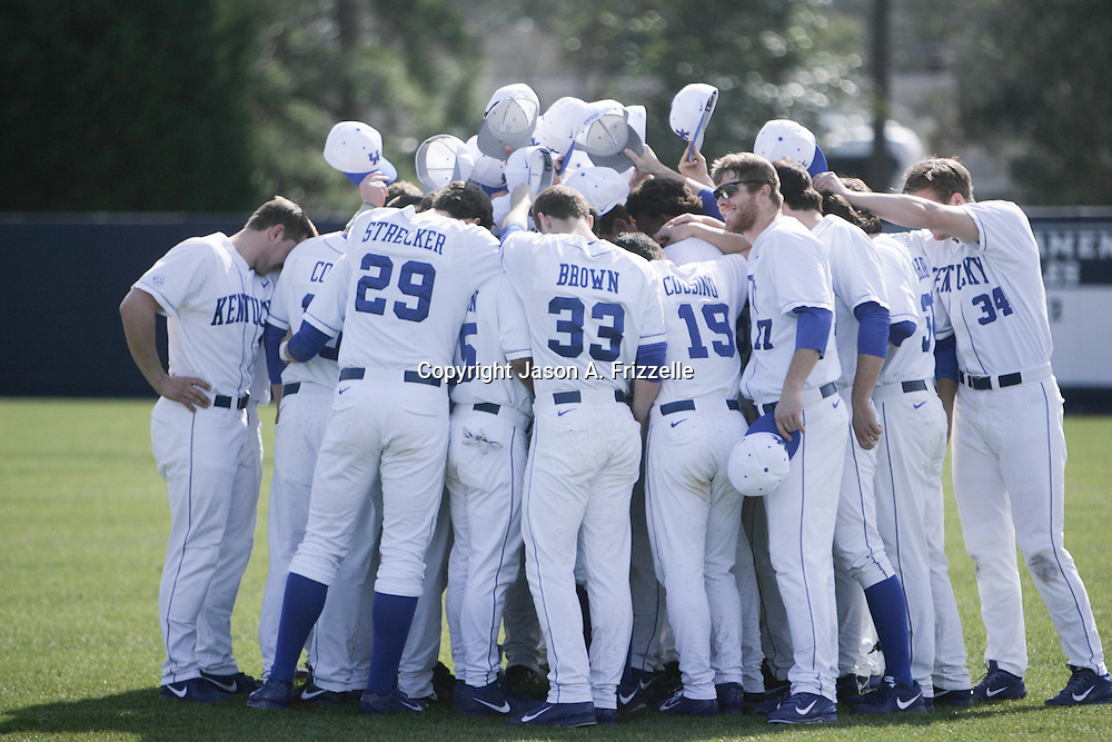Members of the University of Kentucky's Baseball team huddle together before their season opener again the University of Virginia. The university of Kentucky faced the University of Virginia in the opening game of the Hughes Brothers Challenge Friday February 14, 2014 at Brooks Field on the campus of the University of North Carolina at Wilmington in Wilmington, N.C. (Jason A. Frizzelle)