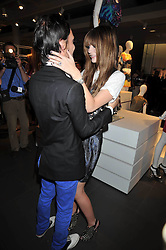 MISCHA BARTON and MATTHEW WILLIAMSON at a party to celebrate the launch of the Matthew Williamson collection at H&M held at the H&M store, Regent Street, London on 22nd April 2009.