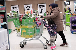 © Licensed to London News Pictures. 03/03/2020. London, UK. A shopper pushes a trolly loaded with cooking oil in a Asda supermarket in Wembley as more Coronavirus disease cases are reported in the the UK. Photo credit: London News Pictures