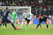 Toni Kroos of Germany battles with Eric Dier of England during the International Friendly match between Germany and England at Signal Iduna Park, Dortmund, Germany on 22 March 2017. Photo by Phil Duncan.