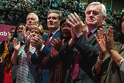 © Licensed to London News Pictures . 24/09/2019. Brighton, UK. Applause from the Labour front bench , including DAWN BUTLER , EMILY THORNBERRY , KEIR STARMER , DIANE ABBOTT , JOHN MCDONNELL , as Jeremy Corbyn delivers the leader's speech a day early , on the fourth day of the 2019 Labour Party Conference from the Brighton Centre , after the Supreme Court ruled that Boris Johnson's suspension of Parliament was unlawful . Photo credit: Joel Goodman/LNP