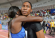 Caster Semnya (RSA), left, is embraced by Noelle Yarigo (BEN) after winning the women's 800m in 1:54.98 during the IAAF Doha Diamond League 2019 at Khalifa International Stadium, Friday, May 3, 2019, in Doha, Qatar