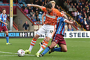 Connor Oliver and Sean McAllister  tussle for the ball during the Sky Bet League 1 match between Scunthorpe United and Blackpool at Glanford Park, Scunthorpe, England on 5 September 2015. Photo by Ian Lyall.