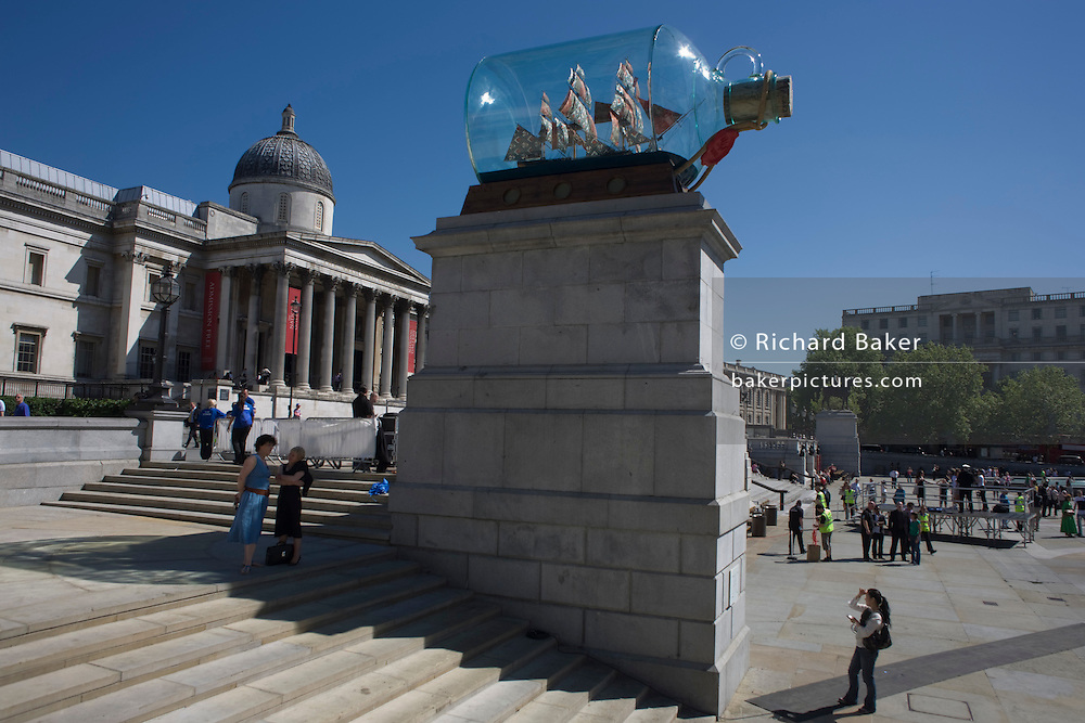 "Artist Yinka Shonibare's artwork Nelson's Ship in a Bottle on Fourth PLinth London's in Trafalgar Square. Shonibare said his version of HMS Victory with its textile sails with African and batik prints reflects the multicultural and diverse capital. The 2.35m high ship inside a specially-made glass bottle, which is a 1:29 scale replica of the original HMS Victory, will be in place for 18 months. 37 large sails are made of patterns which are commonly associated with African dress and culture. The patterns also look back at the path of colonialism as the patterns were inspired by Indonesian batik design, which were mass produced by the Dutch and sold to the colonies in West Africa. Turner Prize-nominated Shonibare said: ""For me its a celebration of London's immense ethnic wealth."