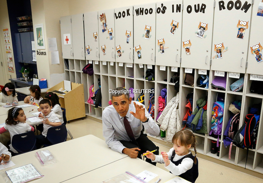 U.S. President Barack Obama (C) sits with Emily Hare as he visits 3- and 4-year olds in a pre-kindergarten class at Powell Elementary School in Washington March 4, 2014. Obama chose the school as a venue Tuesday to propose an expansion of popular tax credits for middle class and working poor Americans in a fiscal 2015 budget designed to serve as a blueprint for Democrats in this year's congressional elections.  REUTERS/Jonathan Ernst    (UNITED STATES)