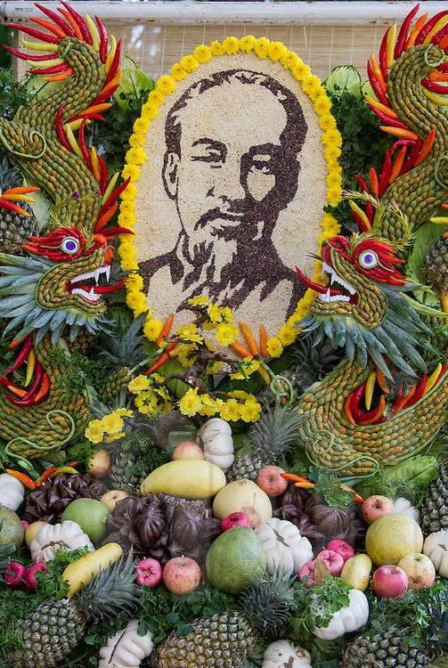 Portrait of Ho Chi Minh created from grains, surrounded by food art dragons, Ho Chi Minh City, Vietnam, Southeast Asia