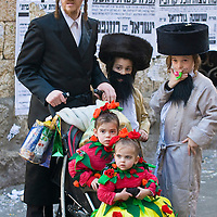 JERUSALEM - MARS 08 : Ultra Orthodox family during Purim in Mea Shearim Jerusalem on Mars 09 2012 , Purim is a Jewish holiday celebrates the salvation of the jews from jenocide in ancient Persia.