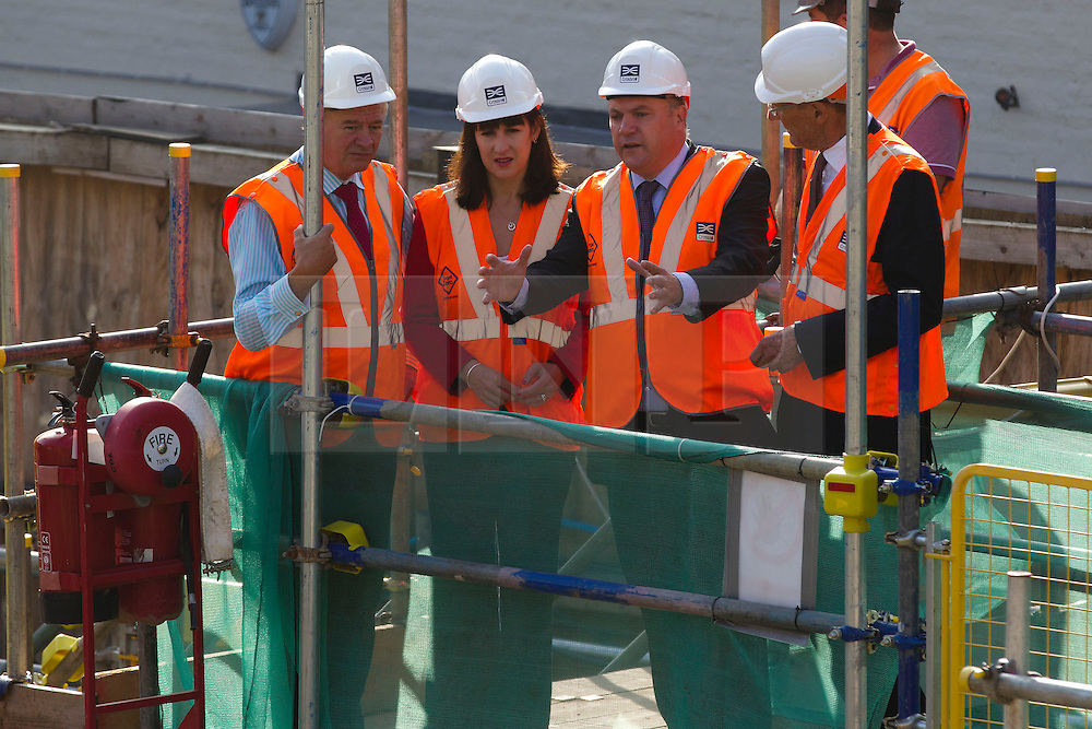 © Licensed to London News Pictures. 05/09/2013. London, UK. Shadow Chancellor Ed Balls (2R), Shadow Chief Secretary to the Treasury Rachel Reeves (2L) and Sir John Armitt chief of a review of long-term infrastructure planning in the UK (R) receive a progress briefing at the site of the Bond Street Crossrail station in London today (05/09/2013) from Terry Morgan, the chairman of Crossrail. The station forms part of the Crossrail train line, which will be 73 miles (118 km) long when finished in 2018, will connect Maidenhead and Heathrow in the west of London to Shenfield and Abbey Wood in the east, passing under central London to create a new commuter link. Photo credit: Matt Cetti-Roberts/LNP