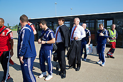 CARDIFF, WALES - Sunday, September 7, 2014: Wales' manager Chris Coleman boards the plane at Cardiff Airport as the squad flies to Andorra ahead of the opening UEFA Euro 2016 qualifying match. (Pic by David Rawcliffe/Propaganda)