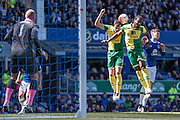 Cameron Jerome (Norwich City) and Ryan Bennett (Norwich City) combine to clear the ball for a corner during the Barclays Premier League match between Everton and Norwich City at Goodison Park, Liverpool, England on 15 May 2016. Photo by Mark P Doherty.