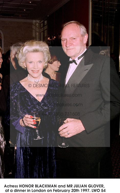 Actress HONOR BLACKMAN and MR JULIAN GLOVER,  at a dinner in London on February 20th 1997.LWO 54