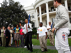 President Barack Obama fences playfully with Olympic Champion Tim Morehouse, during an event on Olympics, Paralympics and Youth Sport Canadian on the South Lawn of the White House, Washington, DC, USA on September 16, 2009. President Obama and his wife Michelle are supporters of  the candidacy of the city of Chicago as the city host for the Summer Olympic Games 2016. Photo by Aude Guerrucci/ABACAPRESS.COM (Pictured: Barack Obama, Michelle Obama, Tim Morehouse)  | 202082_008 Washington