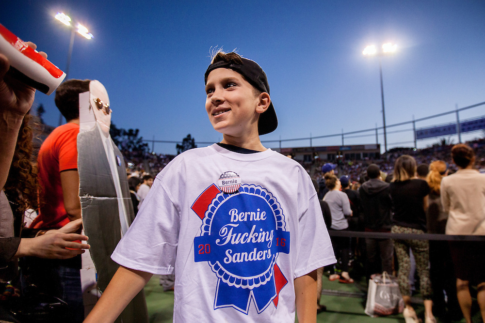 A young Bernie Sanders supporter wears a provocative T-shirt at StubHub Center. May 17, 2016. Carson, Calif. (Photo by Gabriel Romero ©2016)