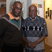 Mr. Johnson, right, and caretaker Mr. Griffin. John E. Johnson, who is not eligible for medicaid, receives services for 12 hours per week through Illinois&rsquo; Community Care Program. Johnson worries his services will be cut if the state transition seniors like him to a new program. The state employs Reggie Griffin to help Johnson with daily chores so he is able to stay in his home, as opposed to going to an nursing home. <br /> Photography by Jose More