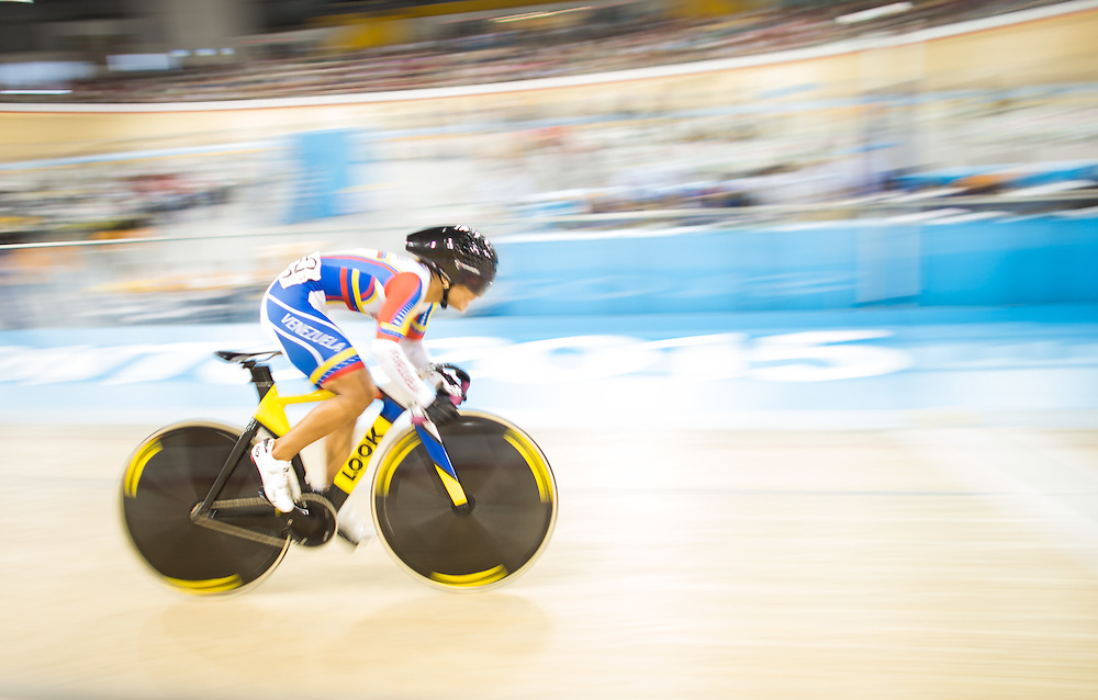 Angie Gonzalez Garcia of Venezuela competes in the women's cycling omnium flying lap at the 2015 Pan American Games in Toronto, Canada, July 19,  2015.  AFP PHOTO/GEOFF ROBINS