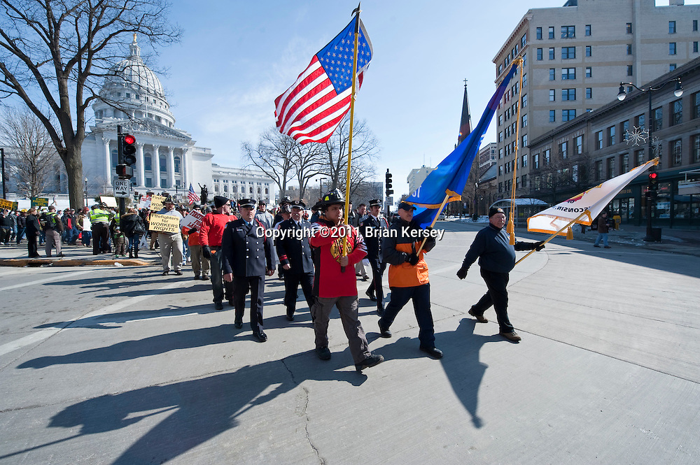 Firefighters march outside of the state Capitol in Madison, Wisconsin on February 25, 2011. Protests over budget legislation continued at the state Capitol for the 11th day.      (Photo by Brian Kersey)