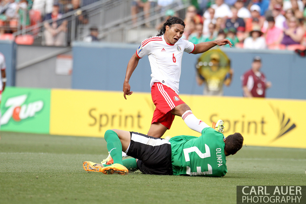 July 14 2013:  Mexico Midfield Carlos Peña (6) attempts to get a shot past the diving Martinique Goalie Kevin Olimpa (23) during the second half of the CONCACAF Gold Cup soccer match between Martinique and Mexico at Sports Authority Field in Denver, CO. USA.