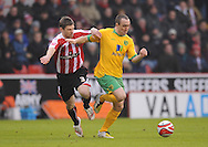 Sheffield - Saturday January 9th, 2009: Gary Naysmith of Sheffield United and Lee Croft of Norwich City during the Coca Cola Championship match at Bramall Lane, Sheffield. (Pic by Alex Broadway/Focus Images)