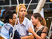 29 OCTOBER 2015 - YANGON, MYANMAR: People get ready to ride a Ferris Wheel during a street carnival in central Yangon. Electricity is scarce in Myanmar, especially in rural areas, and most traveling carnivals use human powered rides. Workers climb to the top of the Ferris Wheel and then pull it around getting it spinning. They do the same with Merry Go Rounds, but instead of climbing to the top they pull it around. The carnival coincided with the Thadingyut Festival, the Lighting Festival of Myanmar, which is held on the full moon day of the Burmese Lunar month of Thadingyut, October or November on the Gregorian calendar. The carnival featured food, rides and games.      PHOTO BY JACK KURTZ