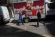 A Tesco delivery van for online purchases and businessmen in the City of London - the capital's financial district, on 6th June 2018, in London, England.