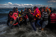 Afghan migrants disembark safely from their frail boat in bad weather on the Greek island of Lesbos after crossing the Aegean see from Turkey, Wednesday, Oct. 28, 2015. Greece's government says it is preparing a rent-assistance program to cope with a growing number of refugees, who face the oncoming winter and mounting resistance in Europe. (AP Photo/Santi Palacios)