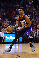 Nov 2, 2016; Phoenix, AZ, USA; Phoenix Suns forward TJ Warren (12) handles the ball during the first half of the game against the Portland Trail Blazers at Talking Stick Resort Arena. The Suns defeated the Trail Blazers 118-115 in overtime. Mandatory Credit: Jennifer Stewart-USA TODAY Sports