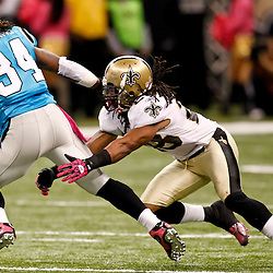 October 3, 2010; New Orleans, LA, USA; New Orleans Saints safety Usama Young (28) tackles Carolina Panthers running back DeAngelo Williams (34) during the second half at the Louisiana Superdome. The Saints defeated the Panthers 16-14. Mandatory Credit: Derick E. Hingle