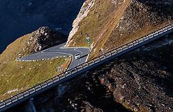 THEMENBILD - ein Auto nach dem Fuschertörl. Die Grossglockner Hochalpenstrasse verbindet die beiden Bundeslaender Salzburg und Kaernten mit einer Laenge von 48 Kilometer und ist als Erlebnisstrasse vorrangig von touristischer Bedeutung, aufgenommen am 15. September 2016, Bruck a. d. Glocknerstrasse, Oesterreich // a car after Fuschertörl.. The Grossglockner High Alpine Road connects the two provinces of Salzburg and Carinthia with a length of 48 km and is as an adventure road priority of tourist interest at Bruck a. d. Glocknerstrasse, Austria on 2016/09/15. EXPA Pictures © 2016, PhotoCredit: EXPA/ JFK