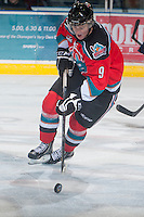 KELOWNA, CANADA - NOVEMBER 1:  Zach Franko #9 of the Kelowna Rockets skates on the ice with the puck against the Kamloops Blazers at the Kelowna Rockets on November 1,  2012 at Prospera Place in Kelowna, British Columbia, Canada (Photo by Marissa Baecker/Shoot the Breeze) *** Local Caption ***