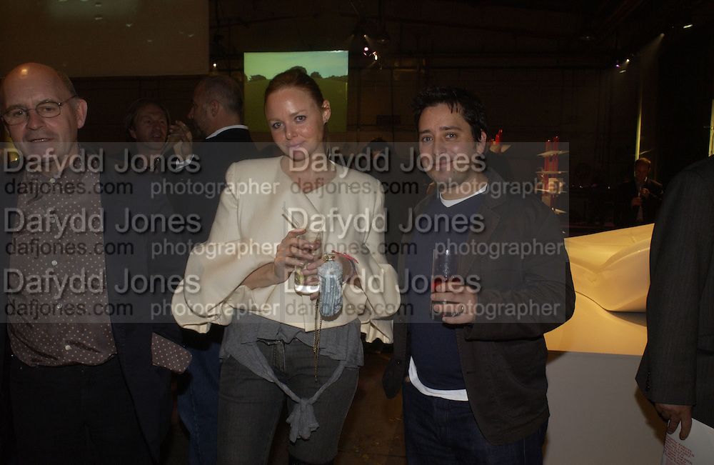 Stella McCartney and Jay Osgerby, Established and Sons UK Launch during Design Week. The Bus Depot, Hertford Road. Hoxton. 22 September 2005.  ONE TIME USE ONLY - DO NOT ARCHIVE © Copyright Photograph by Dafydd Jones 66 Stockwell Park Rd. London SW9 0DA Tel 020 7733 0108 www.dafjones.com