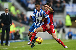 Rajiv van La Parra of Brighton & Hove Albion is tackled by George Friend of Middlesbrough - Mandatory byline: Jason Brown/JMP - 07966 386802 - 19/12/2015 - FOOTBALL - American Express Community Stadium - Brighton,  England - Brighton & Hove Albion v Middlesbrough - Championship