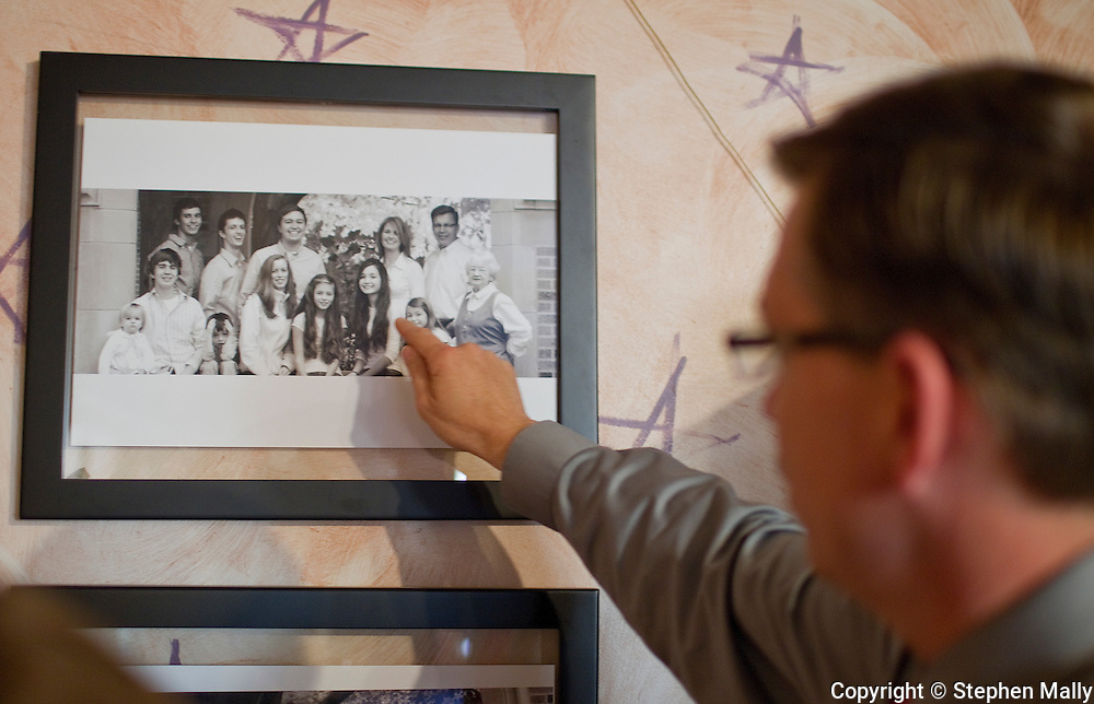 Congressman-elect Robert Schilling (IL-17) points out his children in a family photo at his pizza shop, Saint Giuseppe's Heavenly Pizza, in Moline, Illinois on Tuesday November 9, 2010.