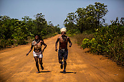 A Xerente indigenous runner and his wife, also a runner train for the 8.5 km competition at their village near Tocantinia, Brazil, Friday, October 2, 2015.  One nearly empty vastness some decades ago, the northern part of Goias state territory, Tocantins was the latest Brazilian state to be created,  27 years ago. Now, luring Brazilians with an abundance of natural resources, its indigenous heritage, an aura of sustainability, infrastructure and lower prices, the government vows that this solid investment package will make up the facade of a land of opportunity. And eventually attract qualified workforce to populate the area. Profiting from side publicity of two world events, Brazil aims at throwing some light on its developmental potential, and has already helped to transform the locally known national indigenous games in the first international event of this type. In some weeks thousands of indigenous athletes from 24 countries will flock to the arena to compete, share and showcase their faces to the world. (Hilaea Media/ Dado Galdieri for the Wall Street Journal)