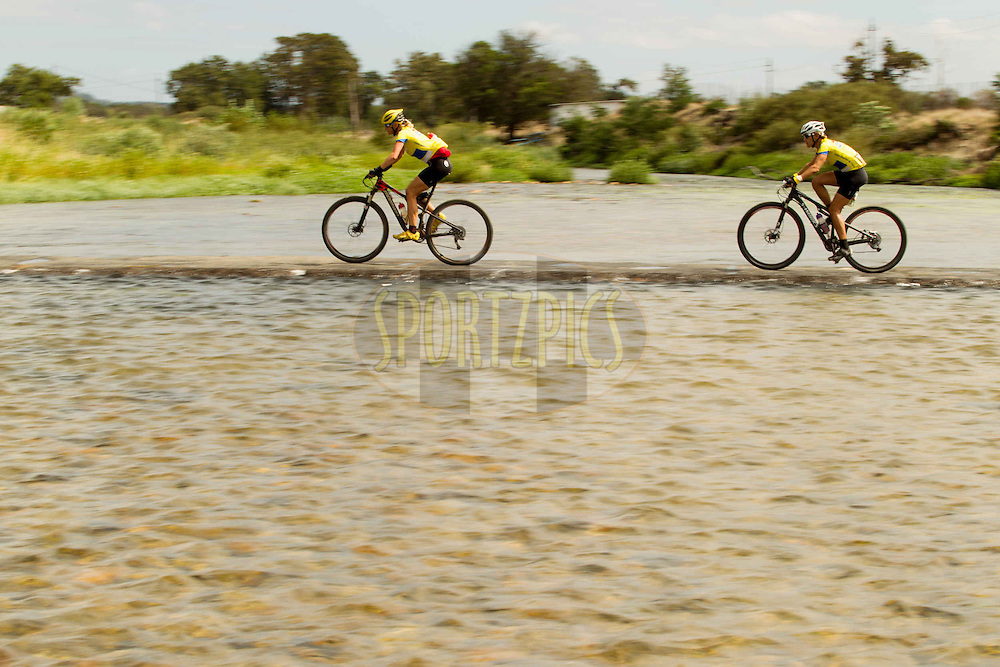 Ann Harrison and Marleen Lourens cross a bridge over the Berg River during stage 6 of the 2013 Absa Cape Epic Mountain Bike stage race from Wellington to Stellenbosch, South Africa on the 23 March 2013..Photo by Greg Beadle/Cape Epic/SPORTZPICS