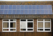 Solar PV Photo Voltaic panels on the roof of Ringmer community college, Ringmer; East Sussex. This panel, or module, is made up of photovoltaic (PV) cells. PV cells convert sunlight into electrical energy.