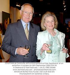JONATHAN & CAROLINE APPLEYARD parents of Zoe Appleyard, at an exhibition in London on 26th September 2002.PDN 44