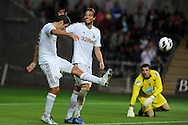 Swansea city's Michu (c) celebrates with Danny Graham. Pre-season friendly match, Swansea city v Blackpool at the Liberty Stadium in Swansea, South Wales on Tuesday 7th August 2012. pic by Andrew Orchard, Andrew Orchard sports photography,