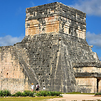 Temples of the Jaguar at Great Ballcourt at Chichen Itza, Mexico<br /> The Temples of the Jaguar towers over the eastern wall of the Great Ballcourt. From the elevated position on the second level, the Mayan ruler and his guests could watch the ball game. The court was also used for major ceremonies, celebrations and inaugurations. The Jaguar name is significant. In the Mayan culture, the big cat represented strength and ferocity. This deity of the underworld also controlled night and day.