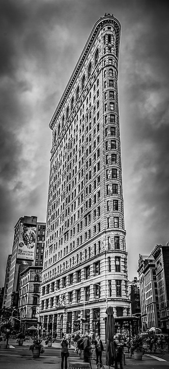 The iconic Flatiron Building in downtown New York City on a warm Fall day.