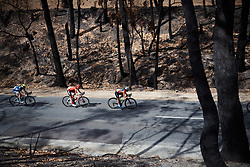 Race leader, Amanda Spratt (AUS) and Juliette Labous (FRA) speed through the charred landscape on Stage 3 of 2020 Santos Women's Tour Down Under, a 109.1 km road race from Nairne to Stirling, Australia on January 18, 2020. Photo by Sean Robinson/velofocus.com