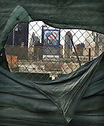 Aug 26, 2003- New York, NY- The pit at Ground Zero as seen through a hole in the cloth barrier. -Photo by Gary Dunkin