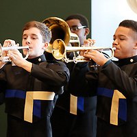 Thomas Wells | BUY AT PHOTOS.DJOURNAL.COM<br /> Jonah Carpenter, 15, left, and Marcus Davis, 15, along with a few members of the Tupelo High School Marching Band perform several patrotic songs before the band leaves for Washington D.C. to attend Friday's Presidental Inguaration.