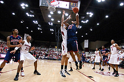 February 3, 2011; Stanford, CA, USA;  Arizona Wildcats forward Derrick Williams (23) shoots past Stanford Cardinal forward Dwight Powell (33) during the second half at Maples Pavilion.  Arizona defeated Stanford 78-69.