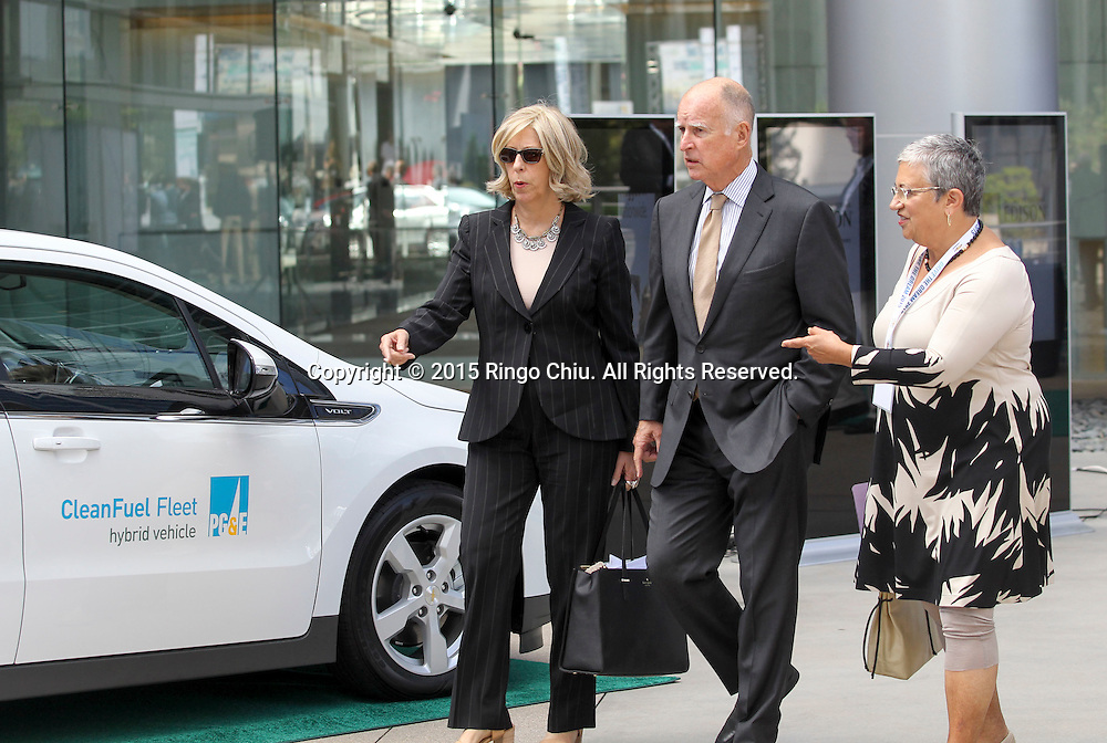 California Gov. Jerry Brown, center, arrives in Drive the Dream 2015 event at Creative Artists Agency in Los Angeles October 15, 2015.  (Photo by Ringo Chiu/PHOTOFORMULA.com)
