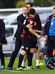 Peterborough United's Lee Tomlin is held back by manager Darren Ferguson after being sent off for an off the ball incident - Photo mandatory by-line: Joe Dent/JMP - Tel: Mobile: 07966 386802 26/10/2013 - SPORT - FOOTBALL - Colchester Community Stadium - Colchester - Colchester United v Peterborough United - Sky Bet League One