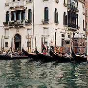 Gondolas with tourists navigate the canal ways of Venice near Piazza San Marco. Venice, Italy. 1st May 2011. Photo Tim Clayton