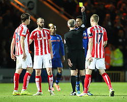 Rochdale's Rhys Bennett receives a yellow card - Photo mandatory by-line: Matt McNulty/JMP - Mobile: 07966 386802 - 26/01/2015 - SPORT - Football - Rochdale - Spotland Stadium - Rochdale v Stoke City - FA Cup Fourth Round