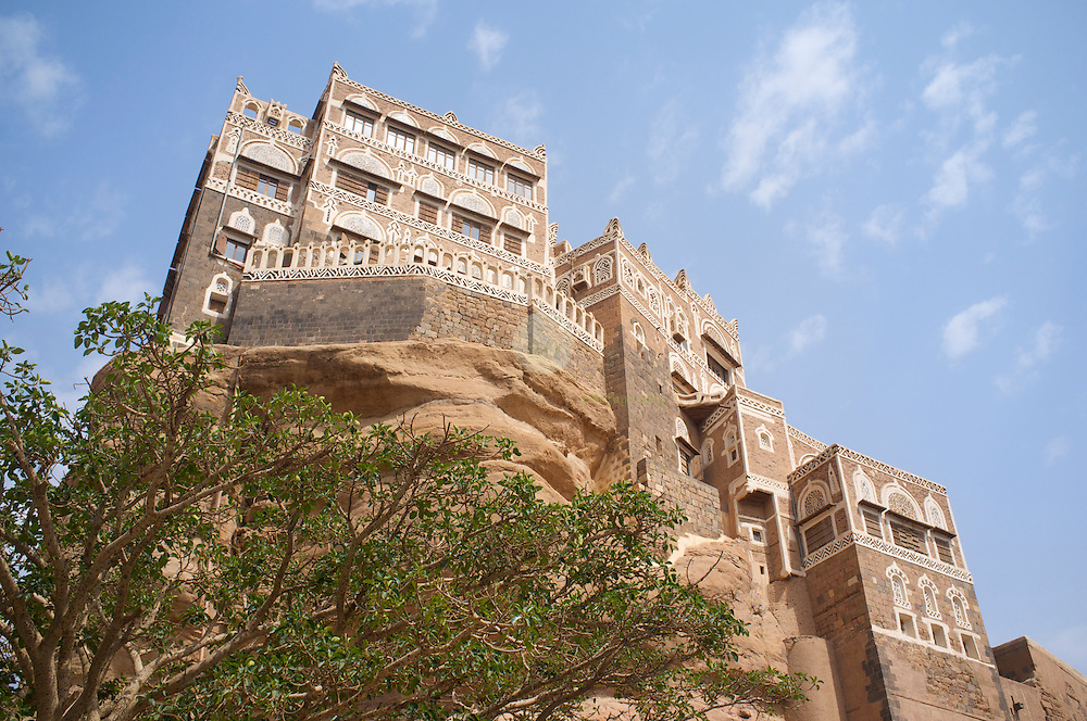 Palace of the Imam in Wadi Dhar: ASIA, YEMEN, WADI DHAR near SANA, 24.06.201: Majestic and unaffected by the recent turmoil in the country stands the famous Palace of the Iman on a giant rock in Wadi Dhar. Wadi Dhahr is located 14 km to the northwest of Sanaa. In the center of the wadi perches Dar Al-Hajar, Rock Palace, built on top of an enormous rock dating back to 1786 AD, and ordered by Imam Mansour Ali Bin Mehdi Abbas. In the 1930s, Imam Yahya Hameed Al-Din added the upper stories and annexes and used it as a rest house.