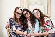Women sleeping on sofa while wearing sunglasses